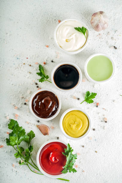 Set of classic sauces Set of classic sauces on white stone concrete stone background. savory sauce stock pictures, royalty-free photos & images