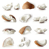 Set of coconut pieces and whole coconut isolated on white background