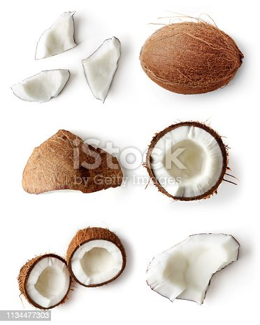 Set of coconut pieces and whole coconut isolated on white background; flat lay