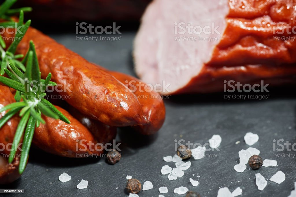 Set of cold cuts on a stone board. Mix of sausages – Foto