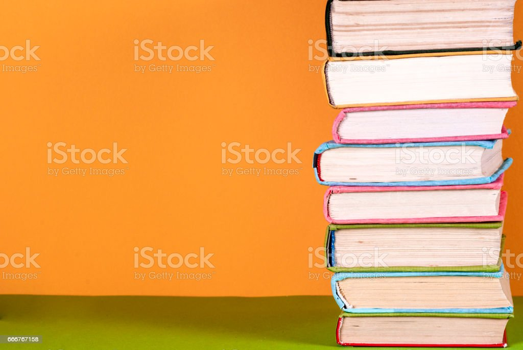 Set of colored books on bright colorful background. Back to school foto stock royalty-free