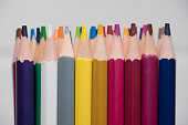 A set of colored pencils, stationery. Lots of colorful pencils on the table. Drawing and Visual Art Kits