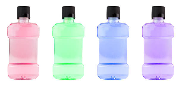 A set of colored plastic bottles of water mouthwash isolated on white background stock photo