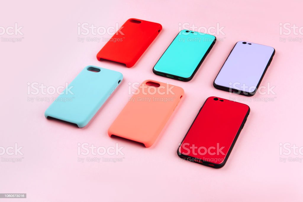Set of colored plastic covers for smartphone isolated on a white background stock photo