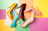 Bright colored women's shoes on a solid background. Copy space text.