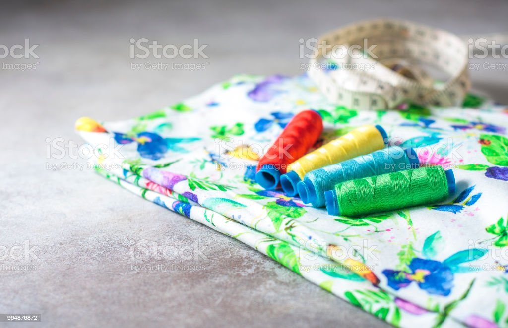 A set of colorful coils on a bright colored fabric. royalty-free stock photo