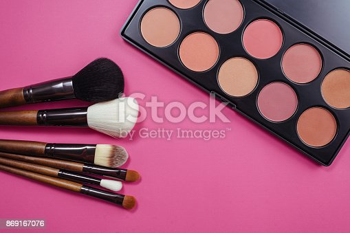 istock Set of colorful cosmetics on pink background 869167076
