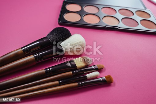 istock Set of colorful cosmetics on pink background 869167160