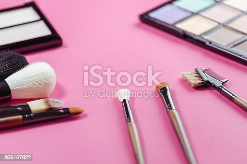 istock Set of colorful cosmetics on pink background 869167622