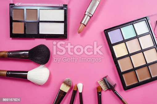 istock Set of colorful cosmetics on pink background 869167624