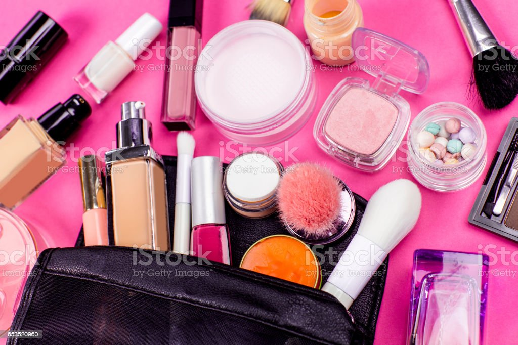 Set of colorful cosmetics on pink table stock photo