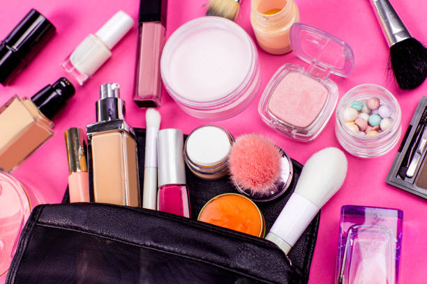 Set of colorful cosmetics on pink table - foto stock