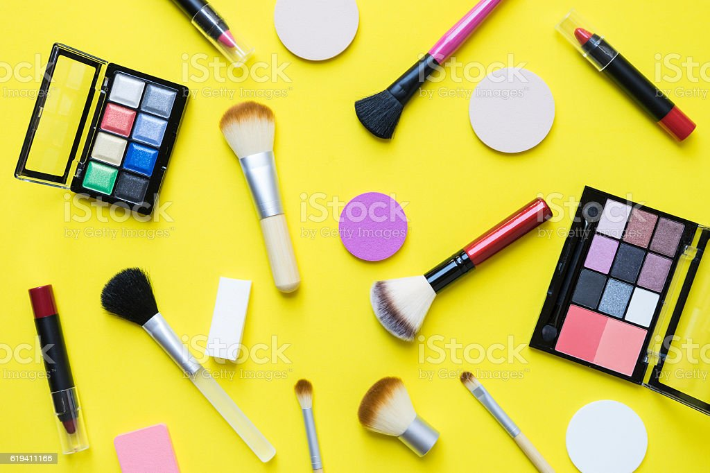 Set of colorful cosmetics on yellow background - foto stock