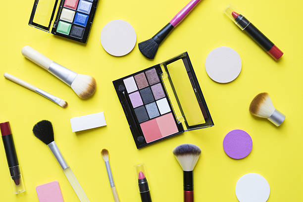 Set of colorful cosmetics on yellow background ストックフォト