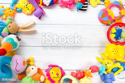 istock Set of colorful Kids toys frame. Copy space for text 879244320