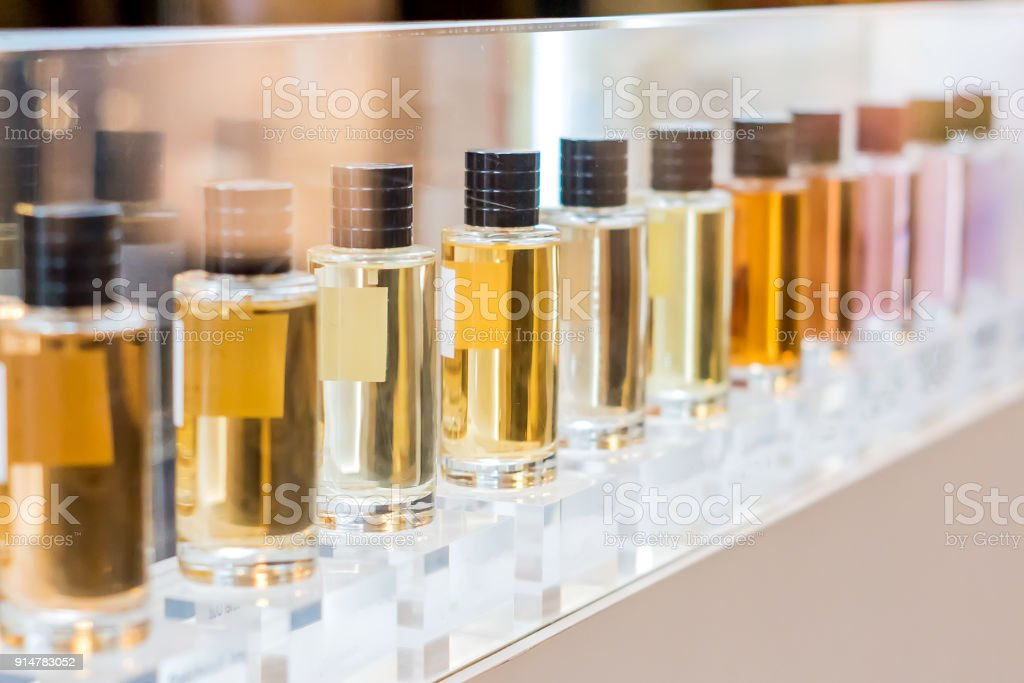 set of colorful perfume bottles in shop window
