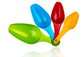 Colorful long plastic spoons isolated on white background