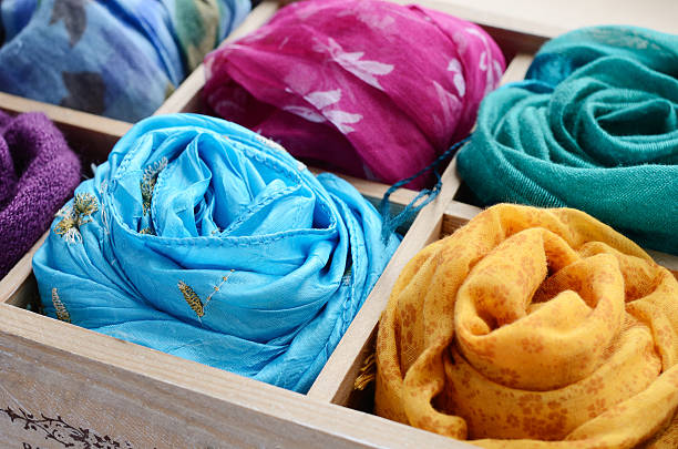 Set of colorful scarves in wooden box Vintage wooden box with different colorful scarves headscarf stock pictures, royalty-free photos & images