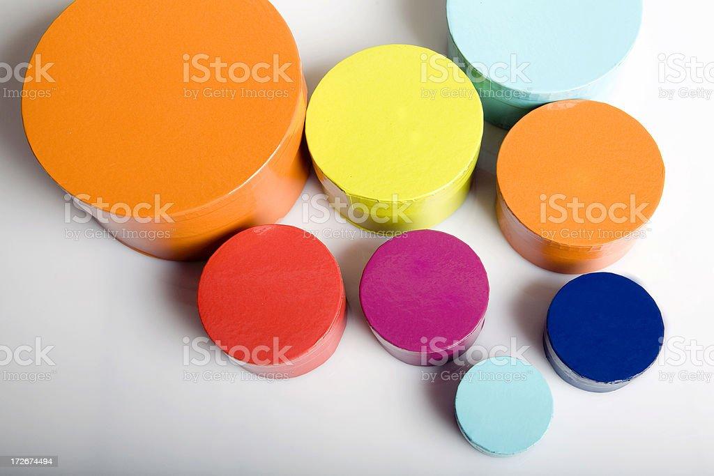 Set of colourful round boxes stock photo