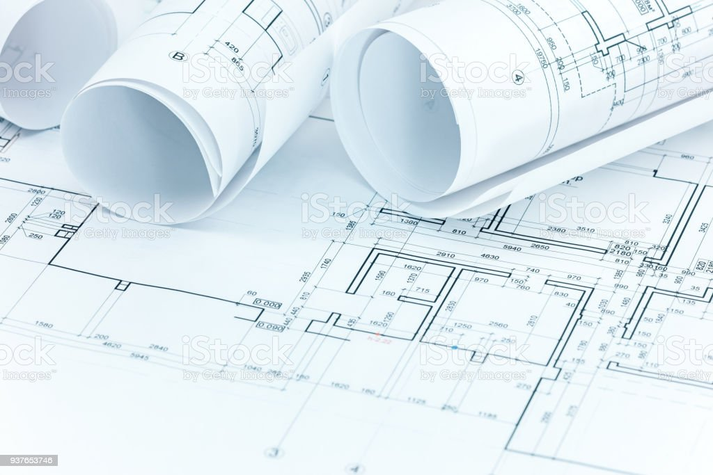 set of construction plans and blueprint rolls on architect workplace desk  royalty-free stock photo