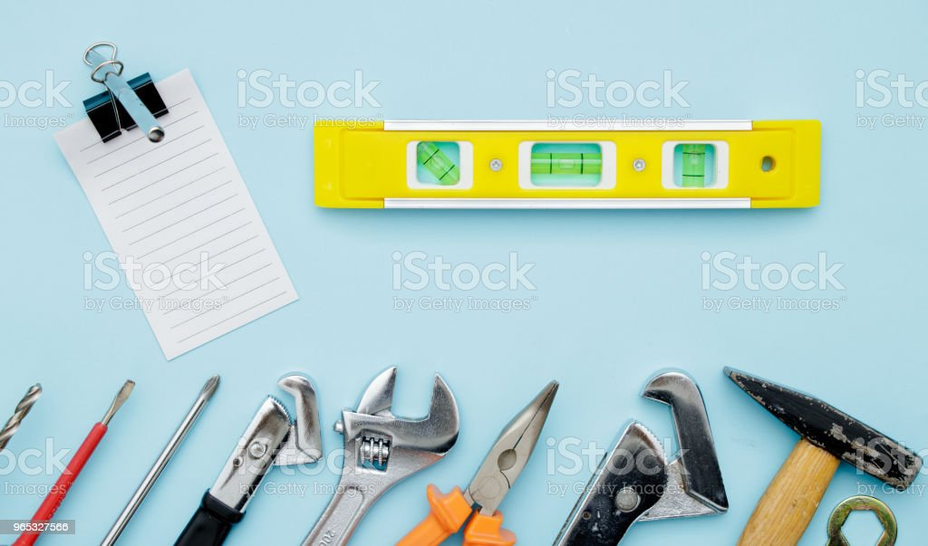 Set of construction tools on blue flat lay as wrench, hammer, pliers, socket wrench, spanner, water balance, electric drill, screwdriver. Fathers day celebration zbiór zdjęć royalty-free