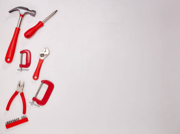 Set of construction tools on white background. Top view with copy space. Concept of construction, renovation or repair. Diy stock photo