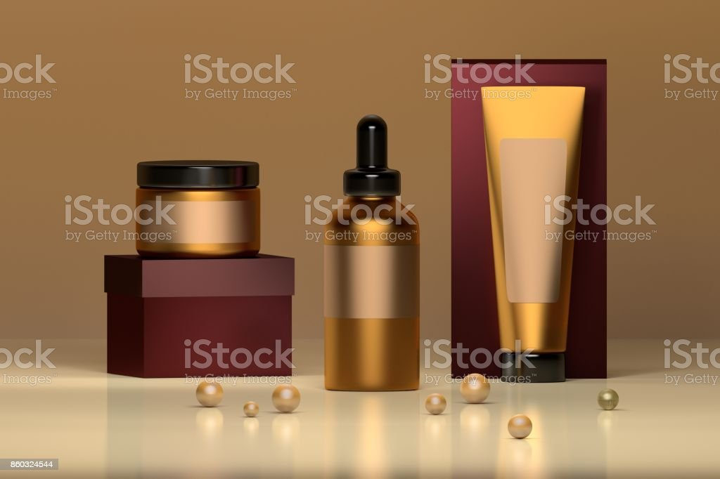 Set of cosmetic bottles in golden colors stock photo