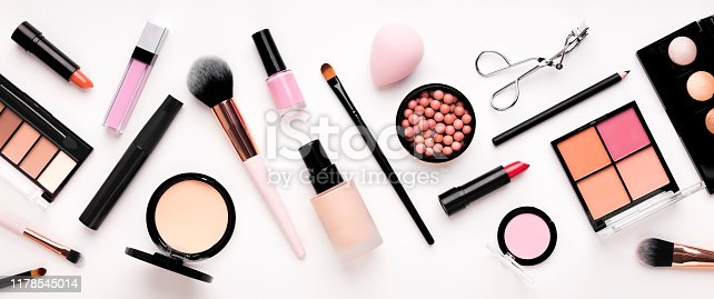 Set of cosmetic products for makeup with natural brushes on white background, panorama