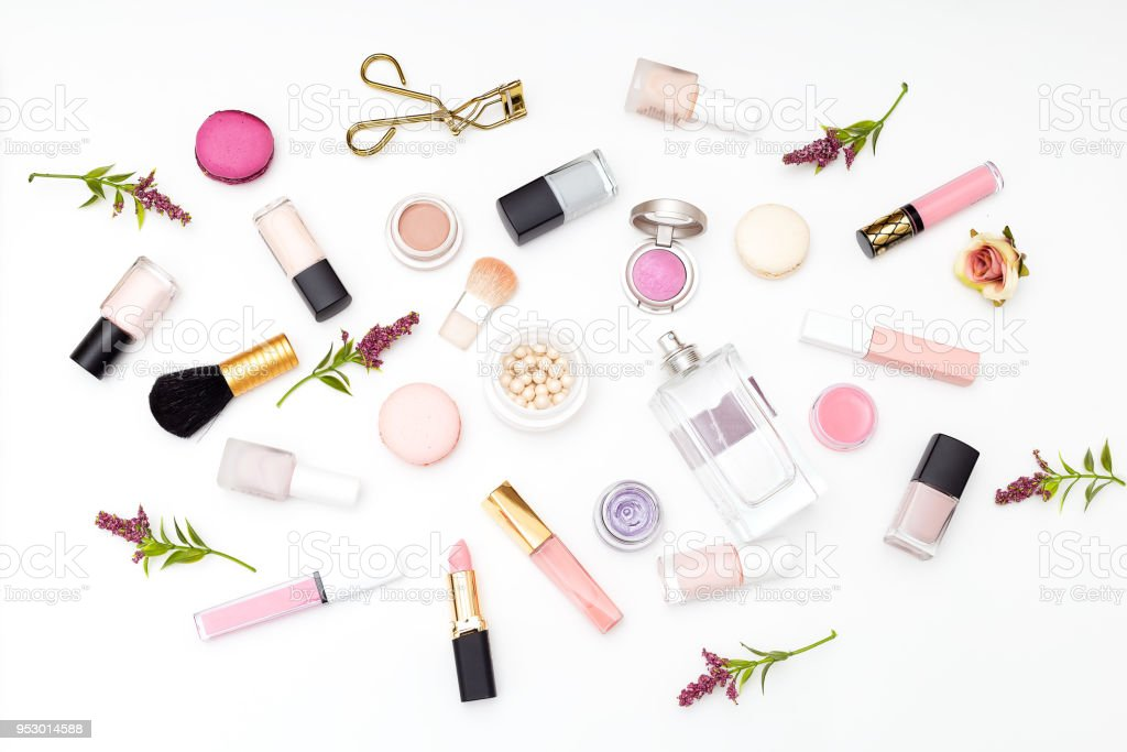 Set of cosmetics on a white background and twigs of flowers. Flat lay stock photo