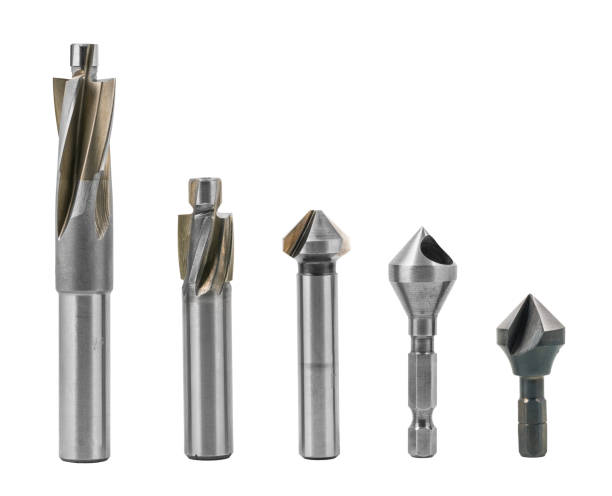 Set of counterbore and countersink drill cutters isolated on a white background Steel cylindrical and conical fluted cutting tools for drilling countersunk or counterbored coaxial holes. Metal silvery instruments for chip machining drill bit stock pictures, royalty-free photos & images