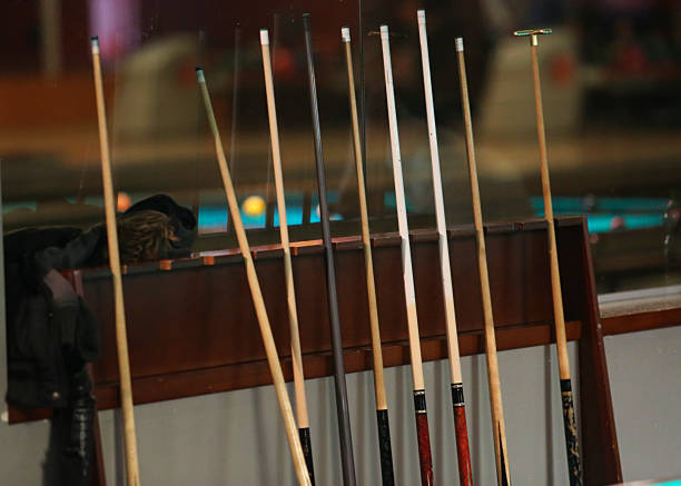 set of cues - pool cue stock photos and pictures