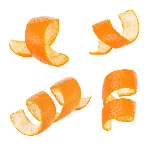 set curl oranje schil geïsoleerd op witte achtergrond - geschild stockfoto's en -beelden