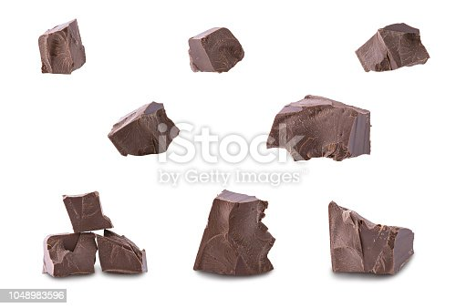 Set of dark broken chocolate pieces isolated on white background