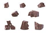 Set of dark broken chocolate pieces isolated on white background