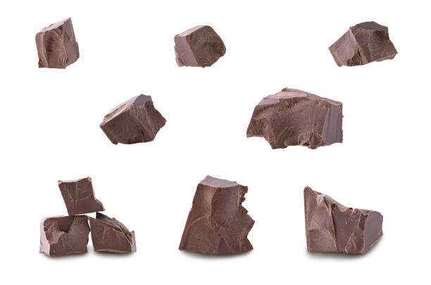 set of dark broken chocolate pieces isolated on white background - chocolate imagens e fotografias de stock