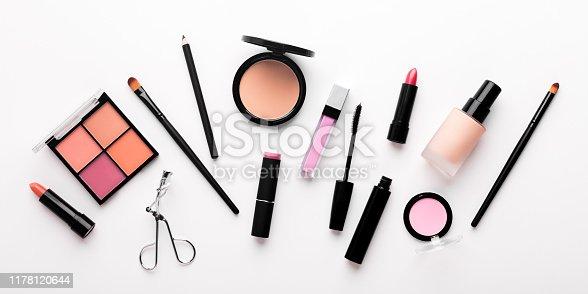 Set of decorative cosmetics for mass market on white background, panorama