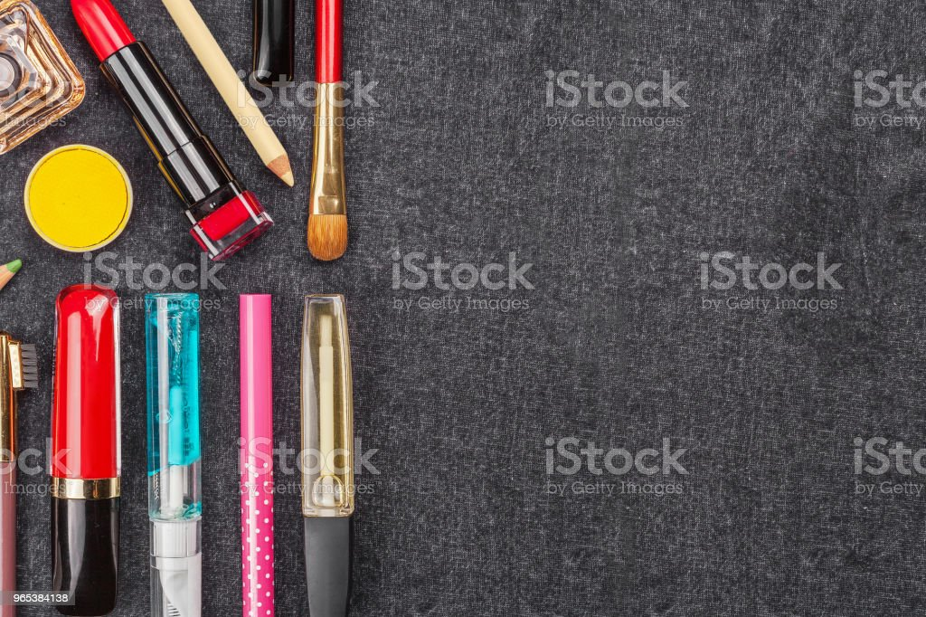 set of decorative cosmetics on a black textile zbiór zdjęć royalty-free