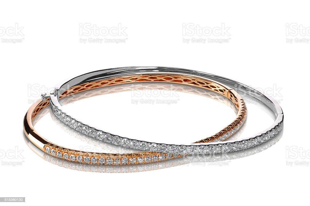 Set of diamond bracelets rose and white gold stock photo