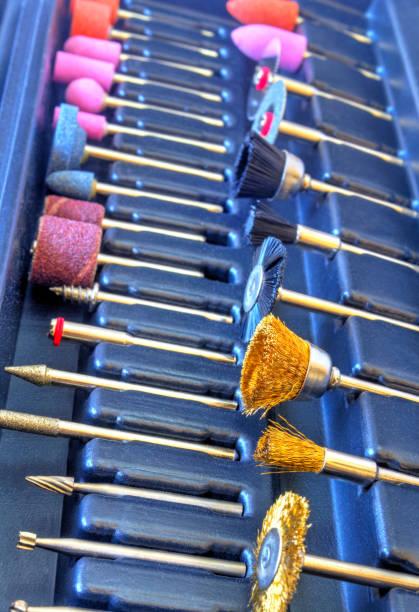 set of different accessories for mini drill machine - dremel zubehör stock-fotos und bilder