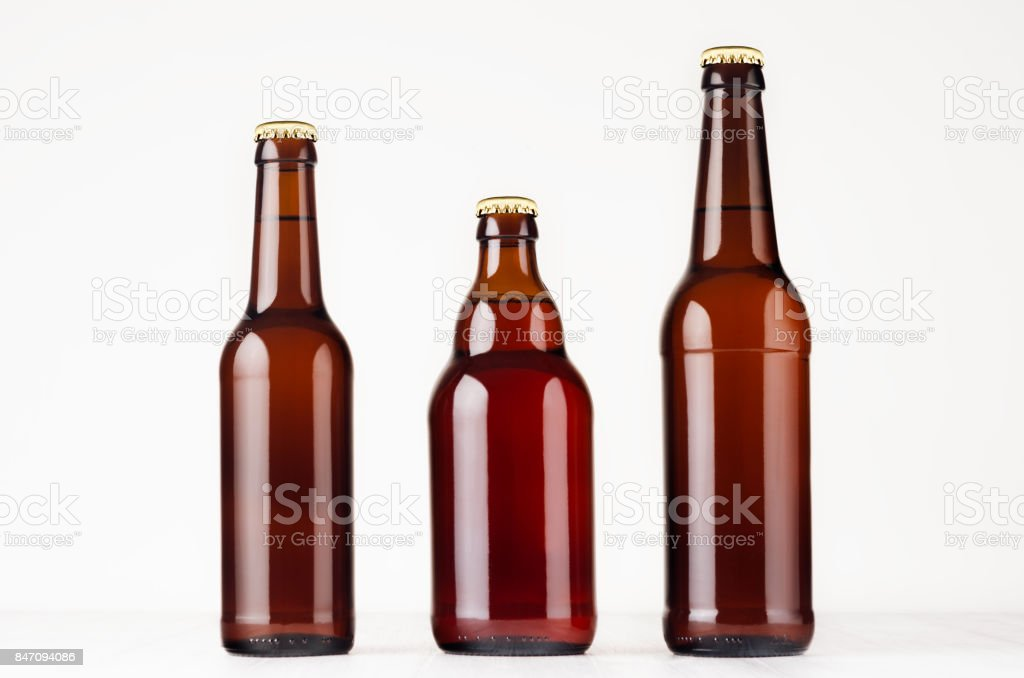 Set of different brown beer bottles  500ml and 330ml mock up. stock photo