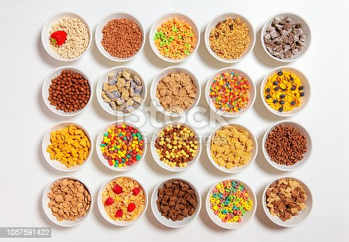 20 bowls with cornflakes, kasha, cereals and berries. the concept of breakfast food. flat lay, top view