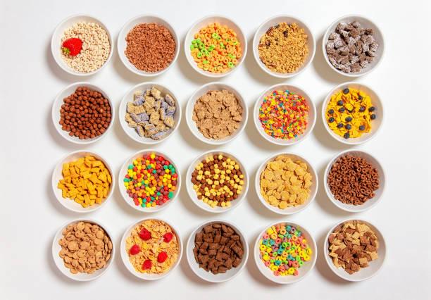 set of different cereals on a white background - muesli imagens e fotografias de stock
