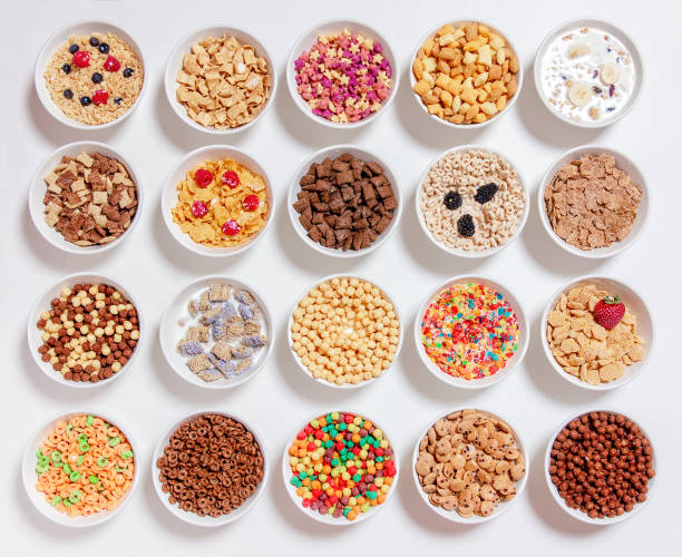 set of different cereals with milk on a white background 20 bowls with cornflakes, kashi, cereals and berries. the concept of breakfast food. flat lay, top view cereal stock pictures, royalty-free photos & images