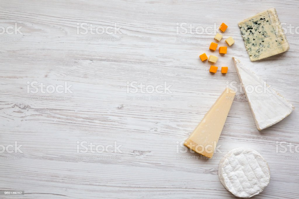 Set of different cheese on a white wooden background with copy space, top view. Food for wine. Flat lay, from above. zbiór zdjęć royalty-free