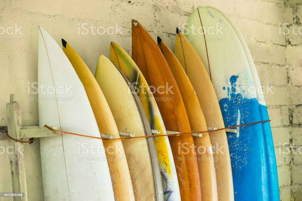 Set of different color surf boards in a stack by ocean.Bali,Indo stock photo