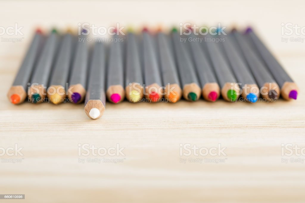 set of different colored pencils on wooden desk royalty-free stock photo