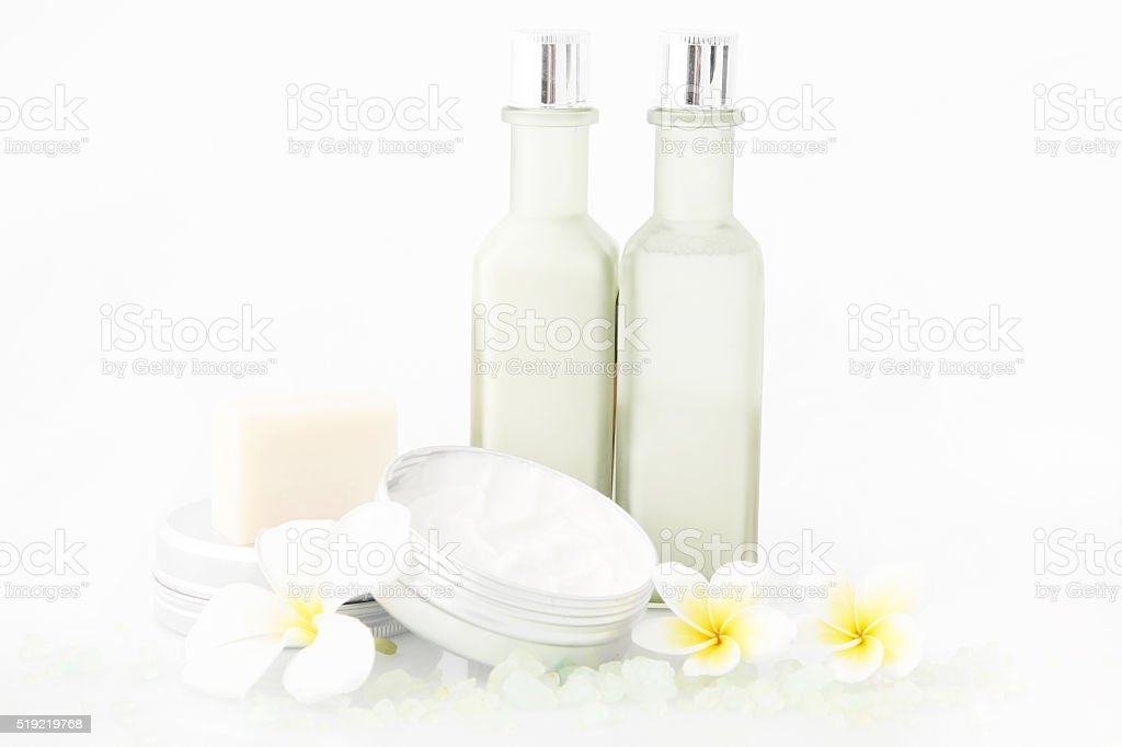 Set of different cosmetic product with frangipani flowers stock photo