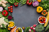 Food frame for rawfoodists. Set of different fresh raw vegetables in glass bowls. Ingredients for vegetarian dishes