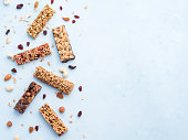 istock Set of different granola bars on blue background 1130187605
