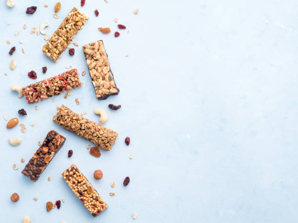 Set of different granola bars on blue background picture id1130187605?b=1&k=6&m=1130187605&s=612x612&w=0&h=uvvtjv h6j fipocdwvaohk5lyts5hzcnscxuusihe8=